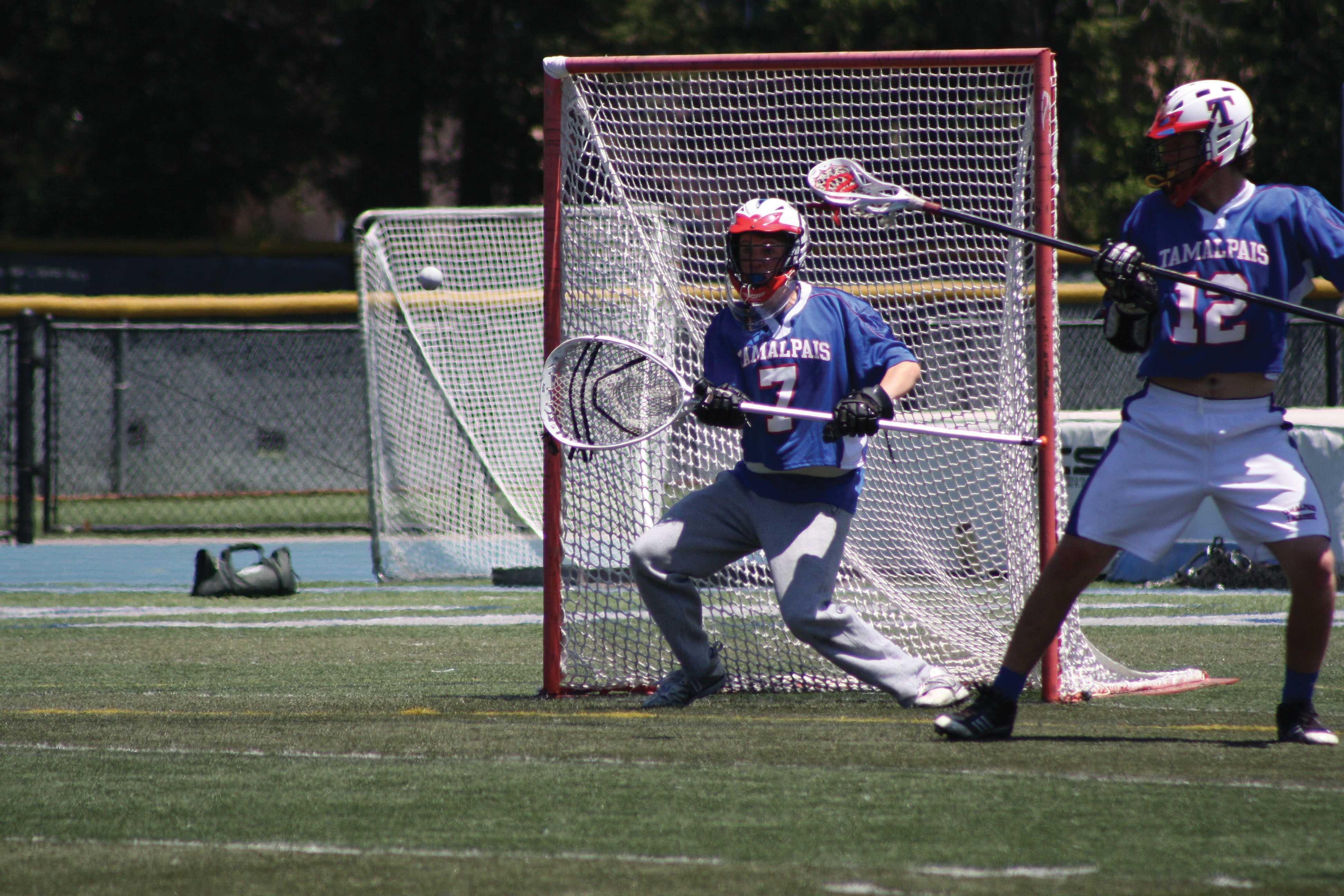SAVE: Goalie Trent Miller blocks a shot during the NCS quarterfinals against Marin Catholic. Photo courtesy of Dina Falk