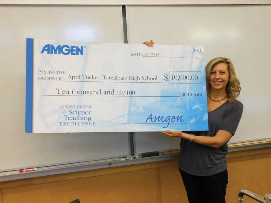 AWARD+WINNER%3A+Ms.+Tucker+was+surprised+with+a+giant+check+from+the+Amgen+foundation.+Photo+by%3A+Emma+Boczek