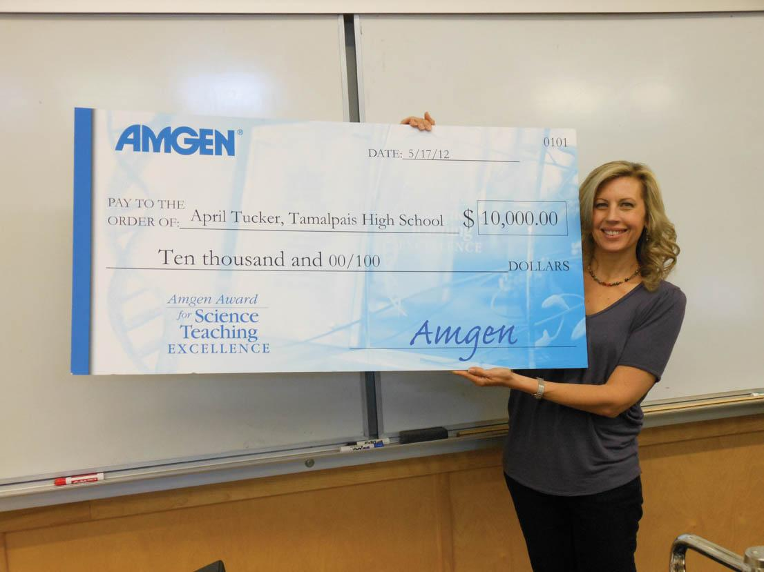 AWARD WINNER: Ms. Tucker was surprised with a giant check from the Amgen foundation. Photo by: Emma Boczek