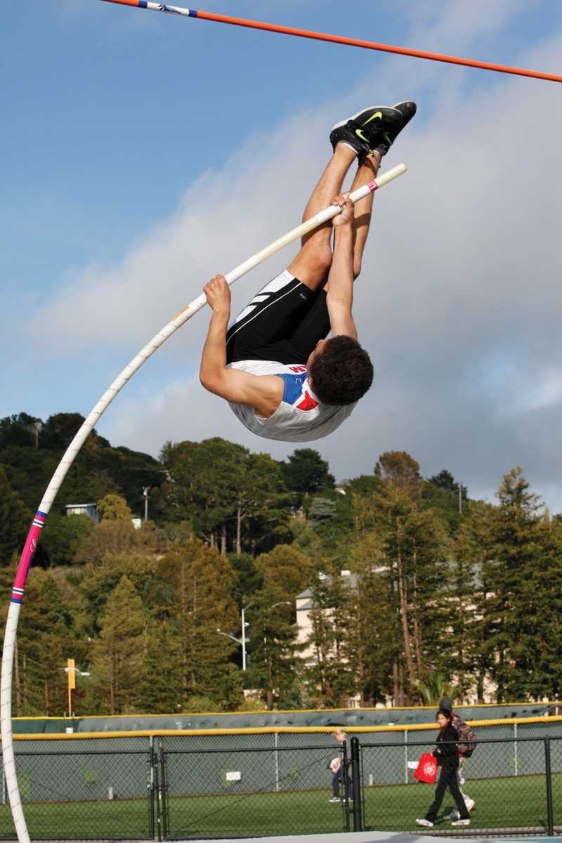 """LIFTOFF: Junior August Kiles has already broken the school record for pole vaulting, at 15' 7"""", and is expected to break the MCAL record this season. Photo by: Isaac Cohen"""