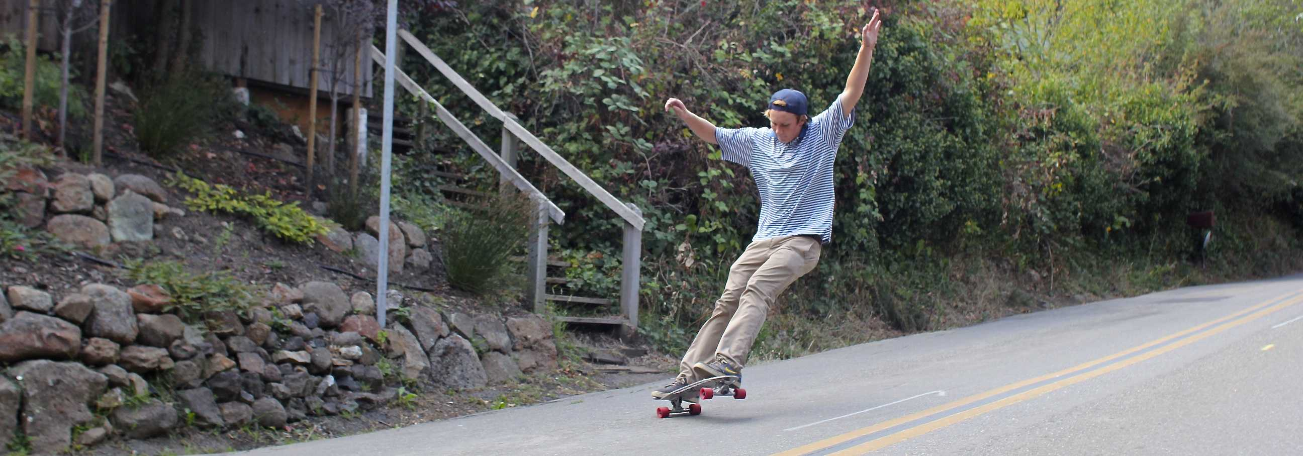 Senior Albert Strietmann rides one of the boards he made for Overland Boards, the company he started with alumnus Spencer Peterson.