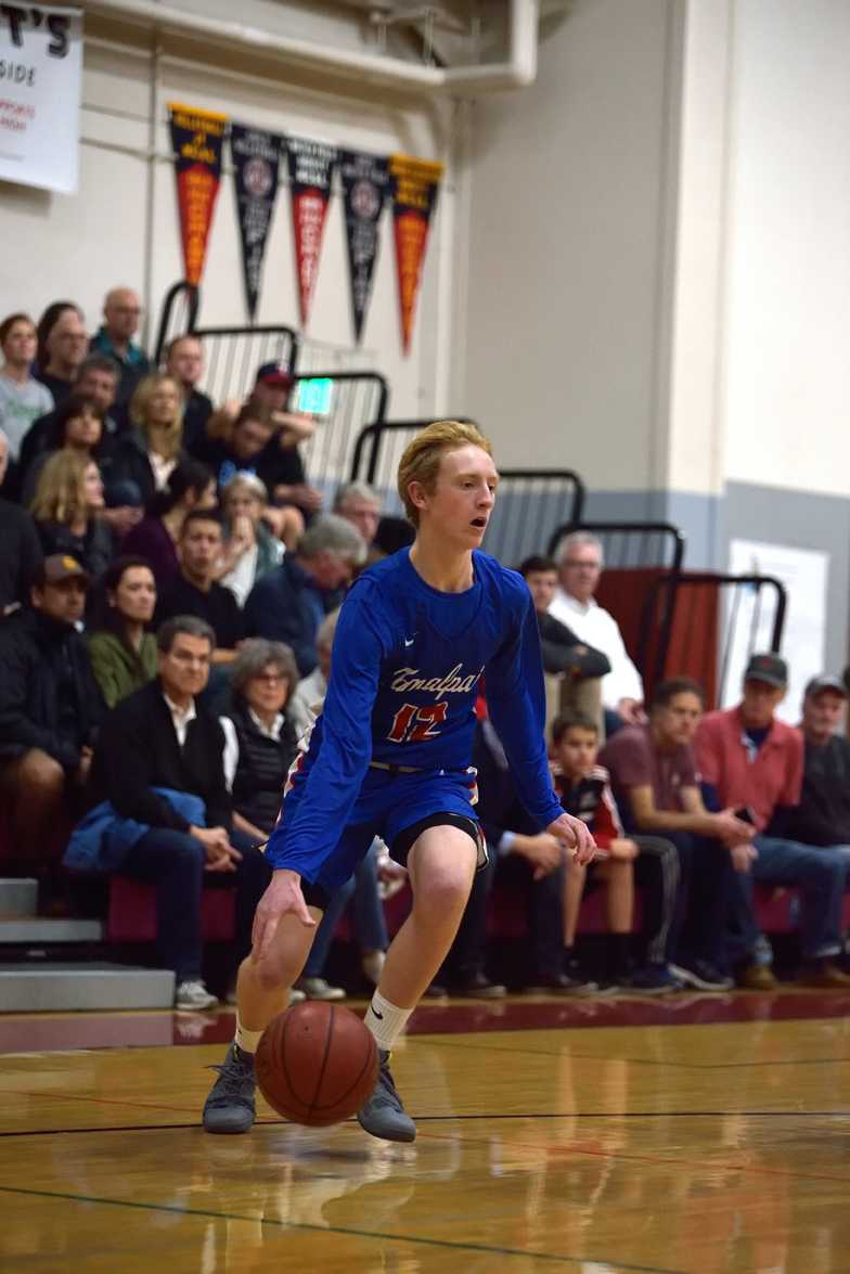 Sophomore Connor Jenkins drives to the hoop at Redwood on January 16