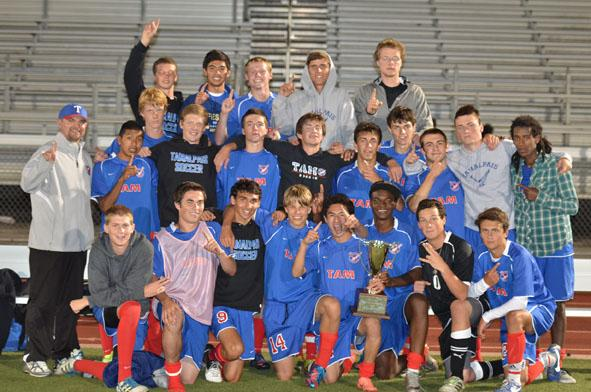 The boys varsity team celebrates their first place finish in the Bay City Invitational tournament on August 24. Photo courtesy of Ken Rosenberg.