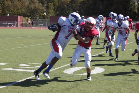 Butler attempting to shake off a Redwood defender on a screen pass