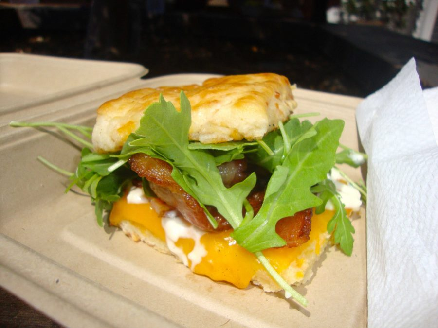 A bacon and cheese breakfast biscuit sandwich from Nick's Wheely good breakfast.