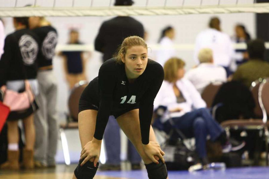 IN THE ZONE: Herzog prepares to receive a serve during an away game. This year marks her final season playing for Tam. Photo courtesy of: Shoshana Herzog