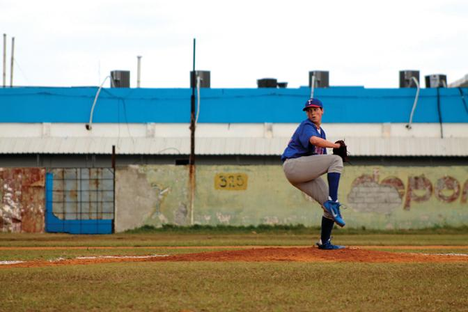WINDUP: Kenny Rosenberg pitched eight strikeouts during a game in Havana, Cuba on February 15, winning 7-1. The baseball and softball teams spent their Febuary break playing against local teams and experiencing Cuban culture. Photo by: Kristie Lee
