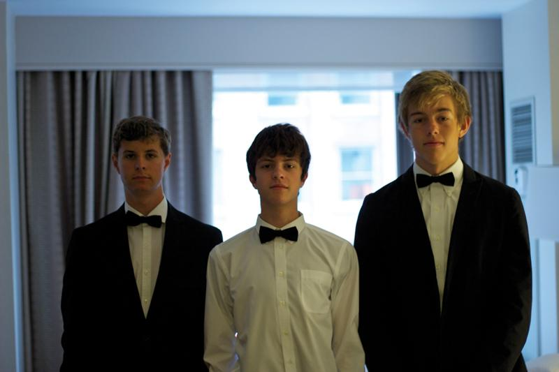 """Juniors Julian Del Castillo, Xan Harris and Dillon Schow (from left) get suited up for the competition. """"I felt nervous, but prepared,"""" Harris said of the morning before the competition."""