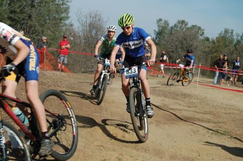 HOT ON HIS TAIL: Freshman Clayton Puckett prepares to pass a Terra Linda rider at a race in Folsom, CA on March 10. Photo courtesy of: Cody Duane-McGlashan
