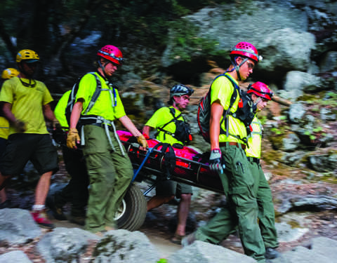 TO THE RESCUE: Due to the rocky terrain in which hikers are often lost or injured, SAR teams use specialized equipment on missions. Photo courtesy of: Rich Shelton