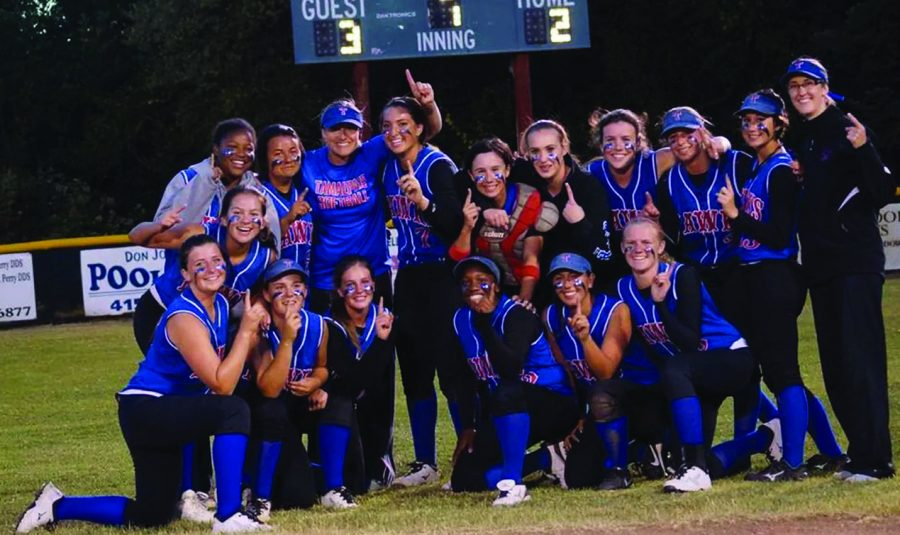 BRINGING HOME THE GOLD: The softball team poses above after winning the NCS championship on May 31 at San Marin High School.This is the first NCS Softball title Tam has every won.