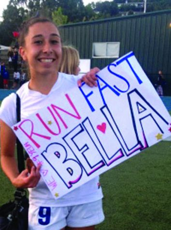 WE GOT SPIRIT: Bella Amyx holds a fans sign after winning the MCAL championship.