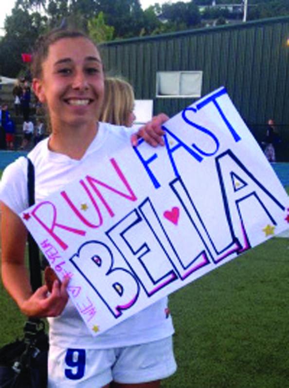 WE+GOT+SPIRIT%3A+Bella+Amyx+holds+a+fans+sign+after+winning+the+MCAL+championship.+++