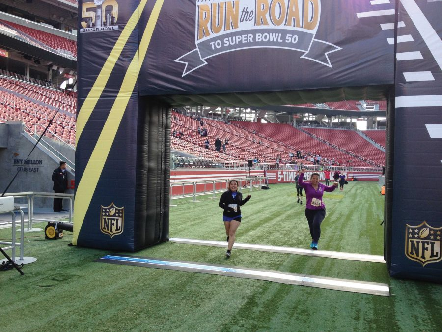 Sophomore Caroline Morena crosses the finish line at the Road to the Super Bowl 10k race at Levi's Stadium.            photo courtesy of: Isaias Franco
