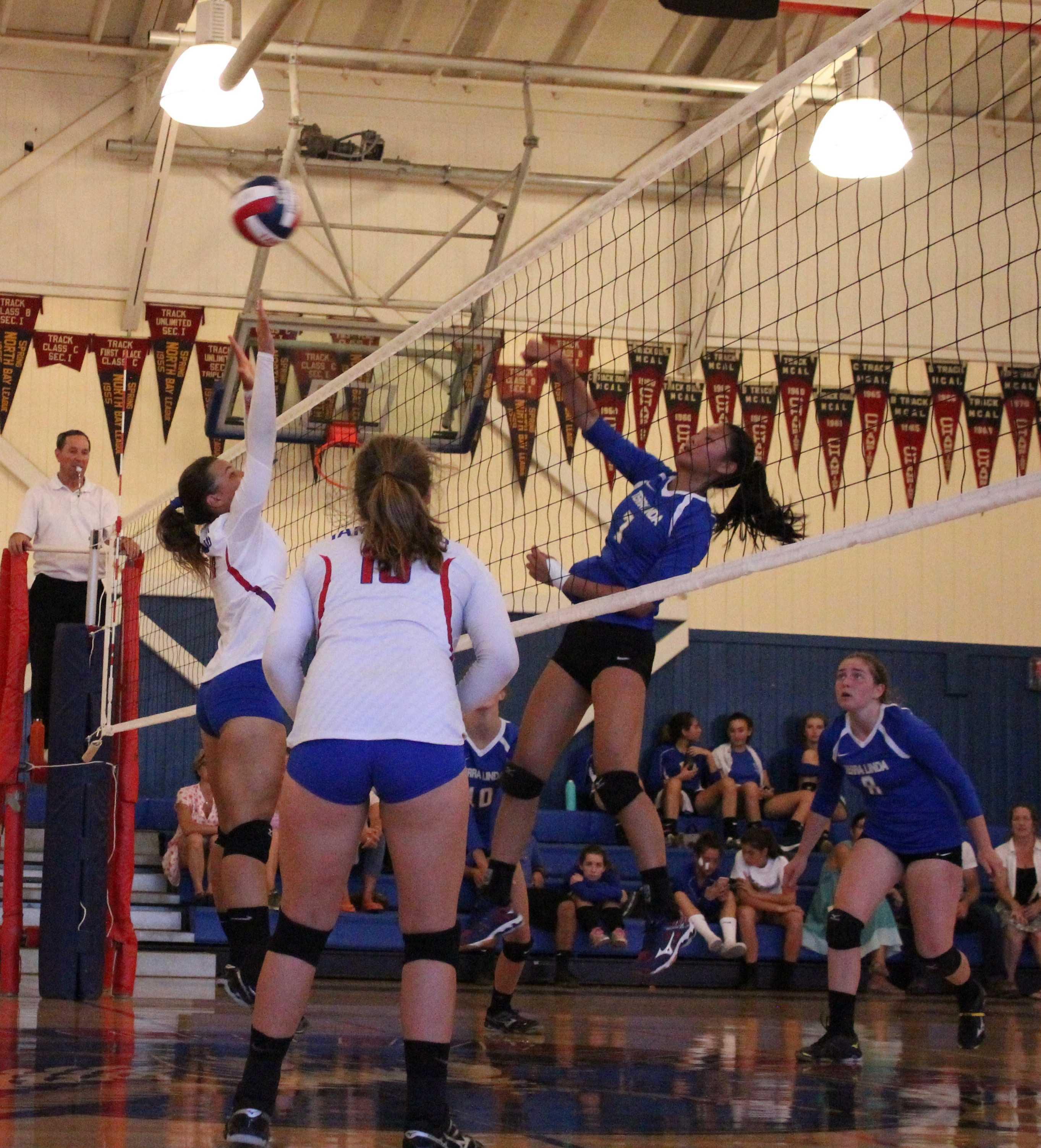 Eva Dmitriyenko leaps for the block.