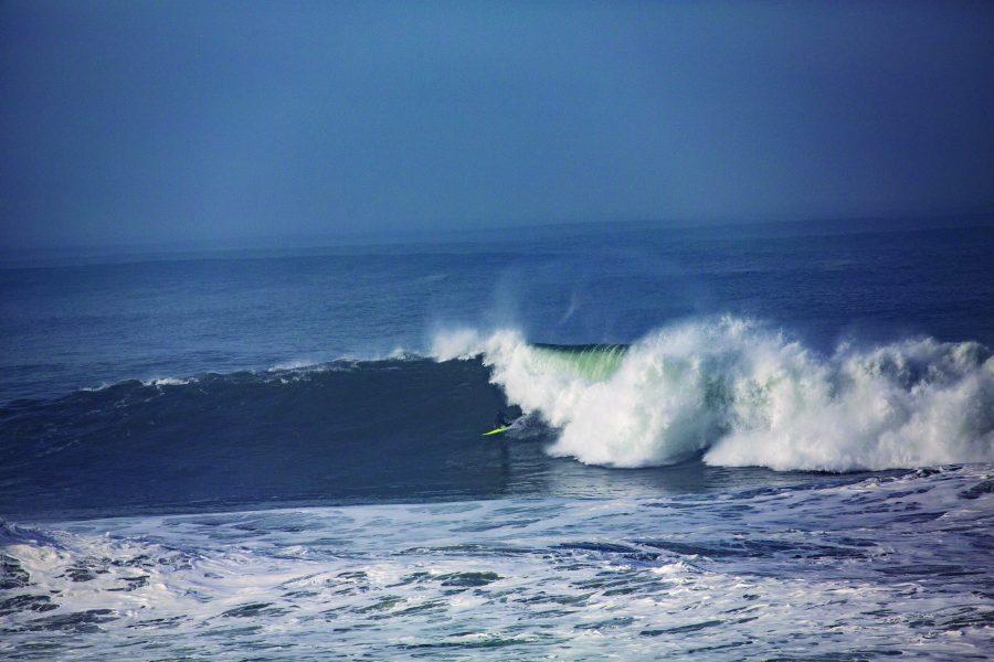 Junior Mac Castaneda rides a massive wave at Ocean Beach in January.