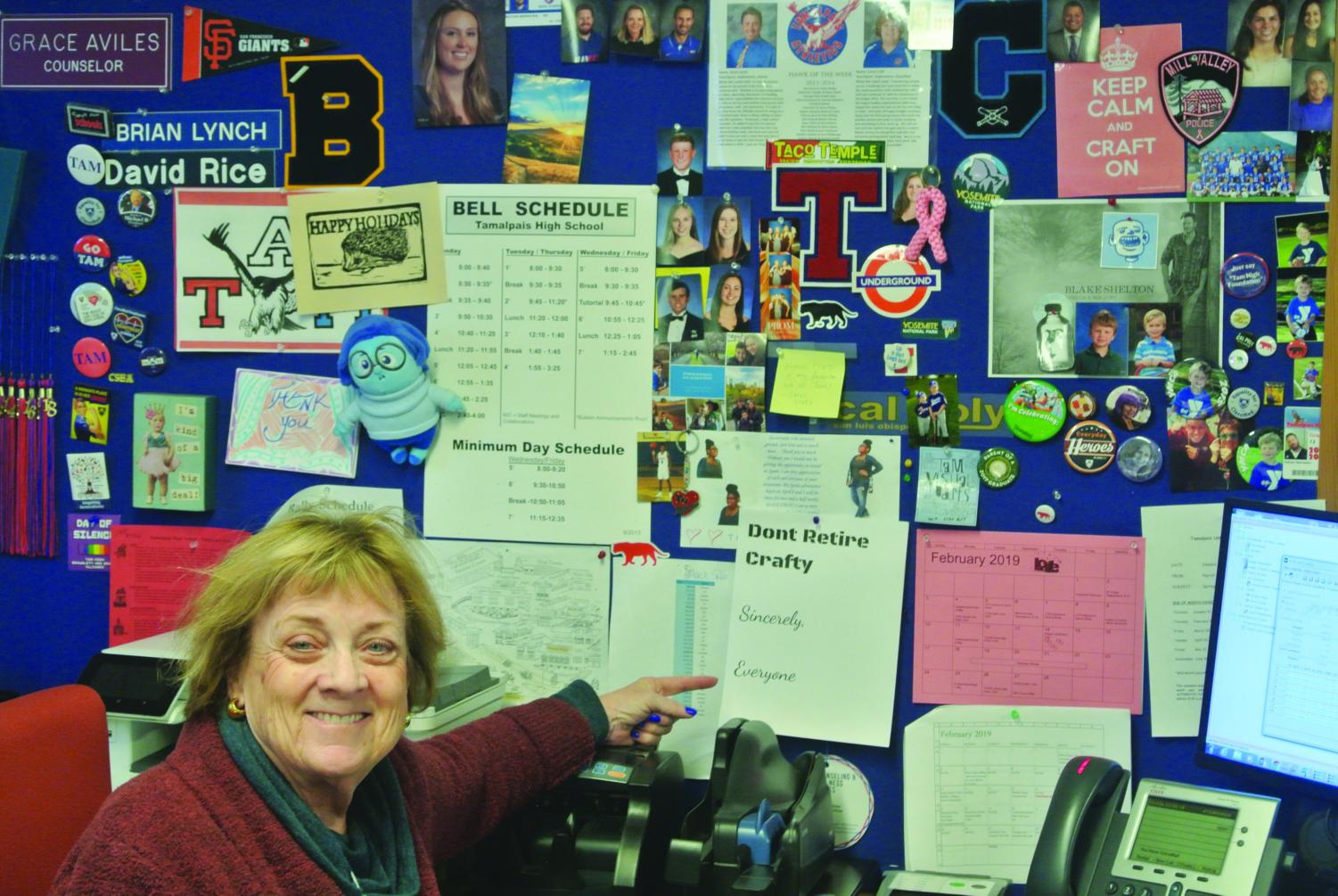 Budget Secretary Carol Craft poses with her wall of mementos.