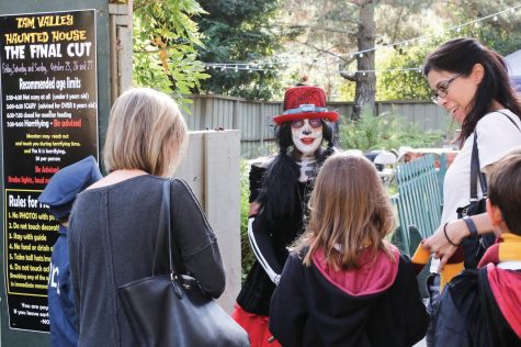 Parks and Recreation Director Carol Buchholz leads tour through Tam Valley's Haunted House. (Courtesy of Stefanie Schwartz)