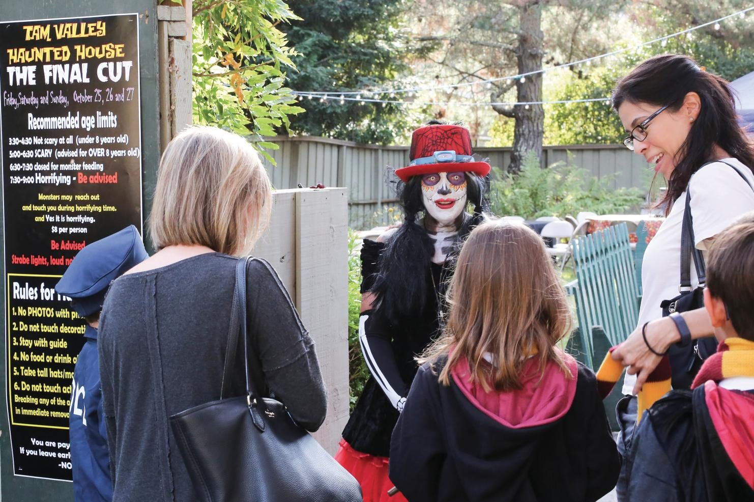Parks and Recreation Director Carol Buchholz leads tour through Tam Valley's Haunted House. (Courtesy of Stefanie Schwartz)