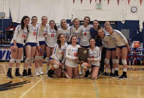 The girls volleyball team poses with their runner-up plaque after falling in the CIF regional state finals. (Courtesy of Talia Smith)