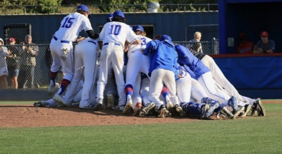 May 13,  the boys vasity baseball team celebrates at the pitcher's mound after defeating Redwood 5-1 and winning the honorary MCAL title. (Courtesy of @tamalpaisbaseball Instagram)